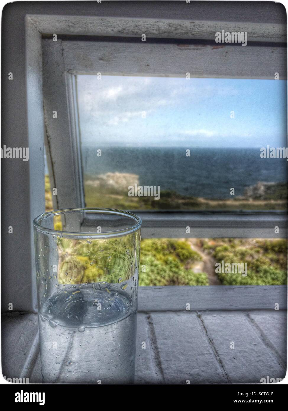 Drink and view. - Stock Image