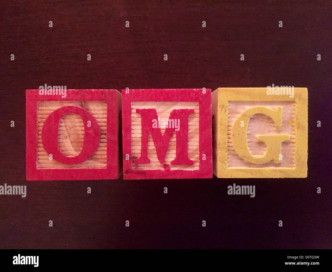 ABC wood block used to spell OMG, 'Oh My God' - Stock Image