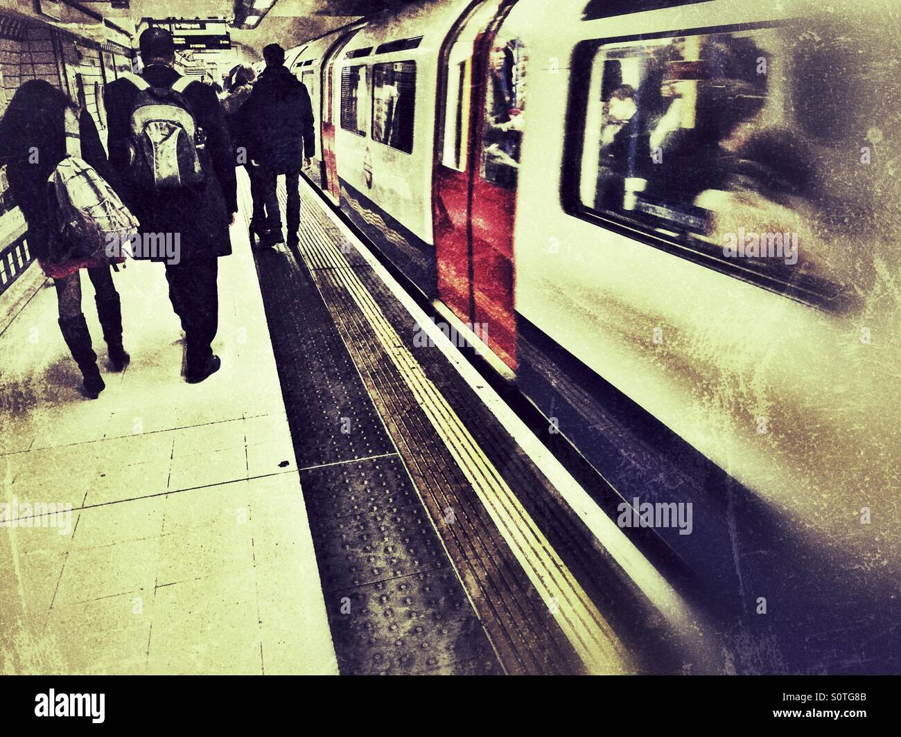 Commuters at Leicester Square tube station, London. - Stock Image