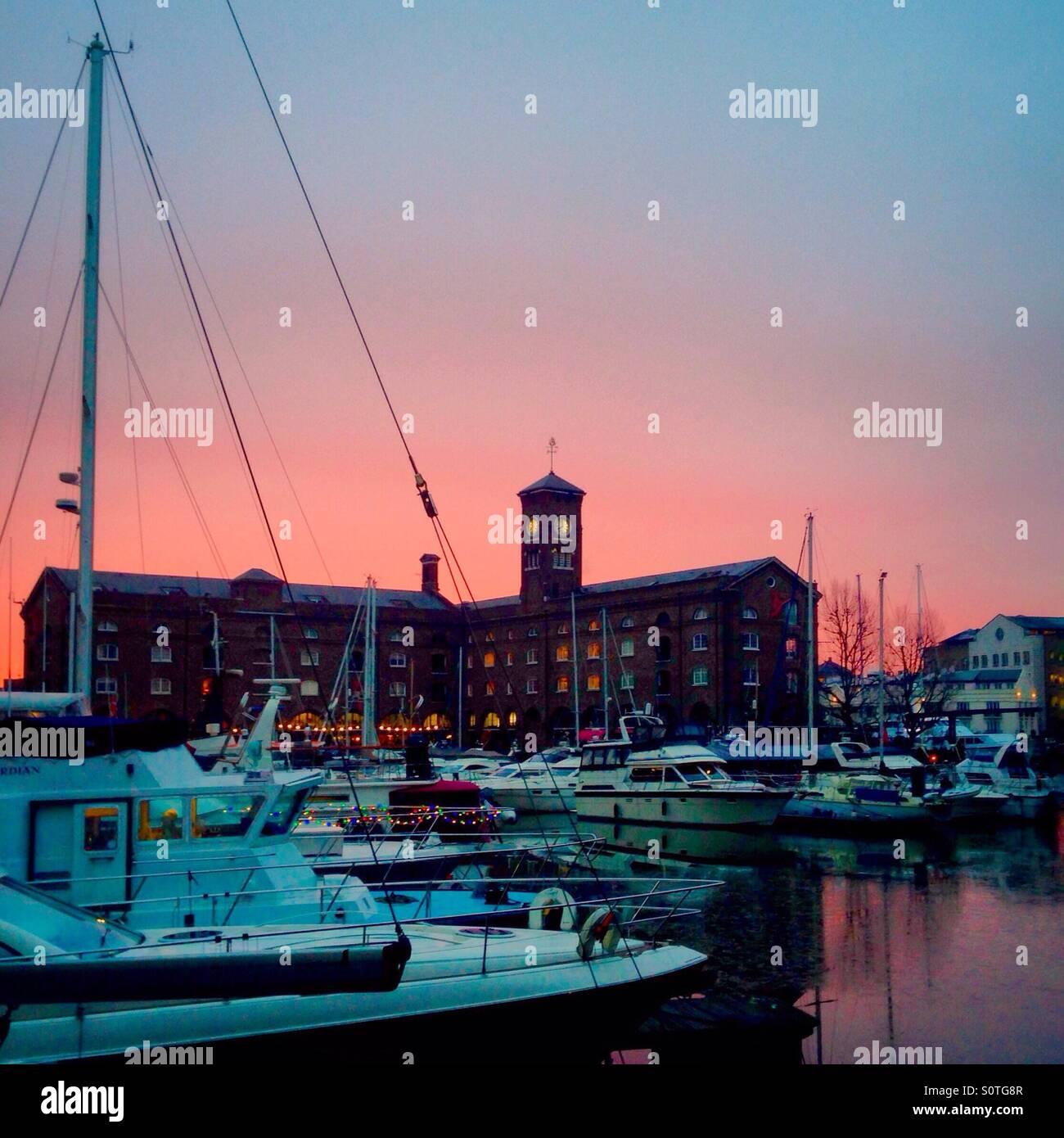 Pink sunrise over St Katharine's Docks - Stock Image
