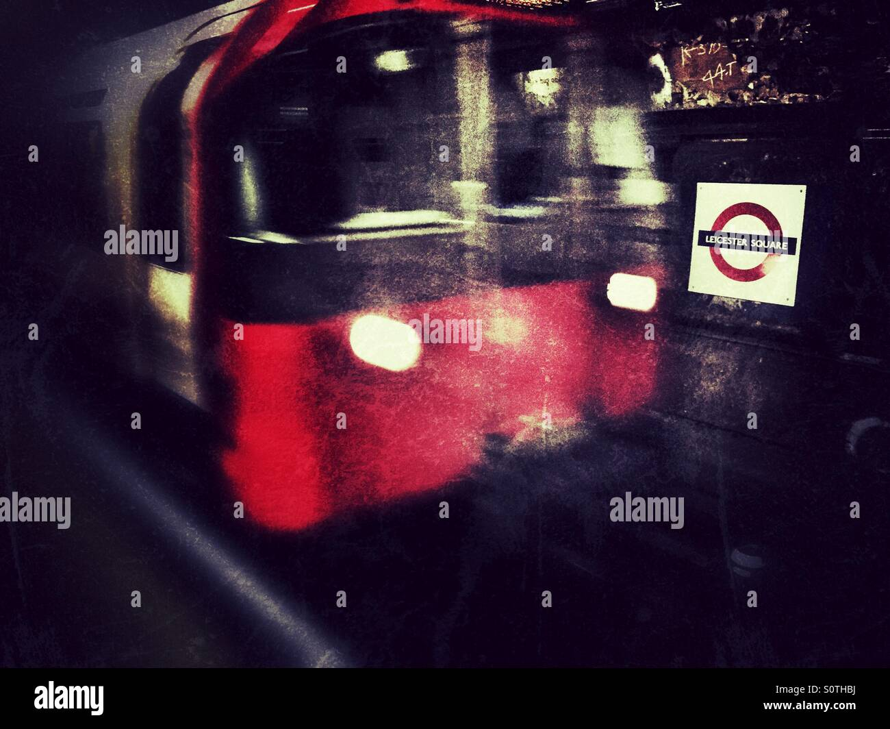 Train approaching Leicester Square station, London - Stock Image