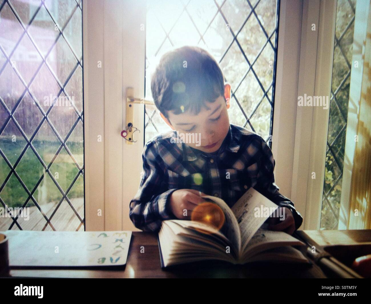 Boy reading - Stock Image