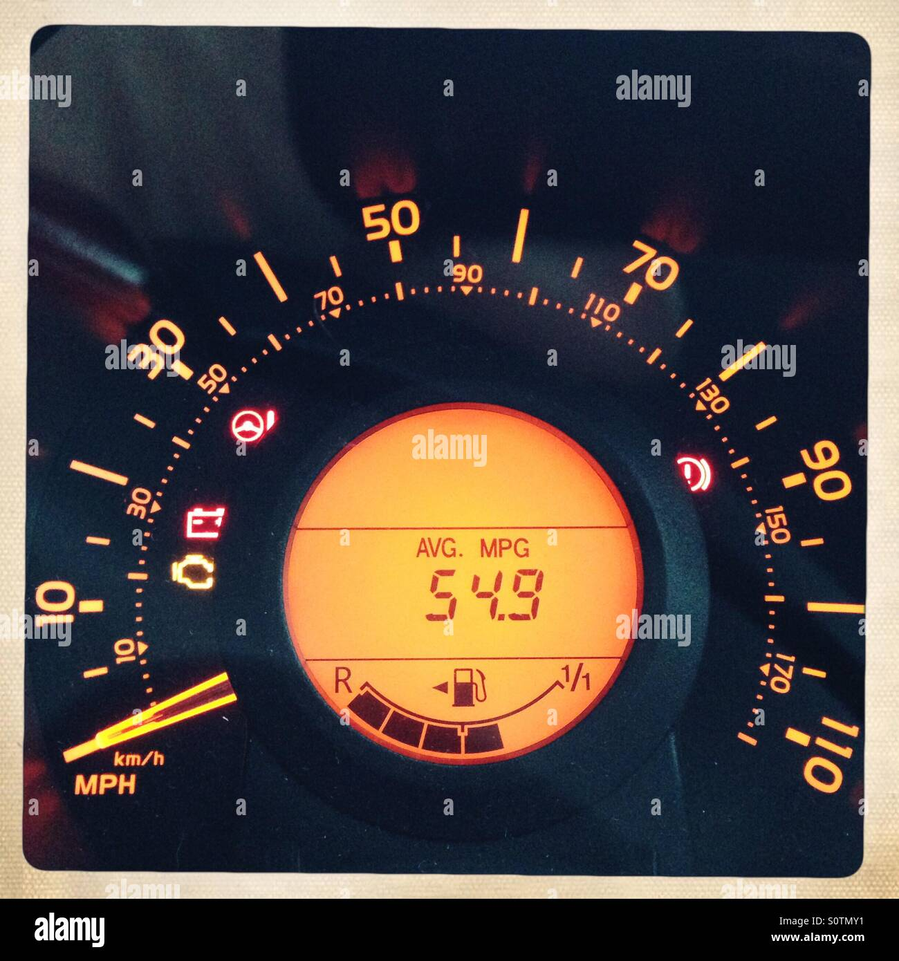 Car speedometer showing average miles per gallon Stock Photo ...