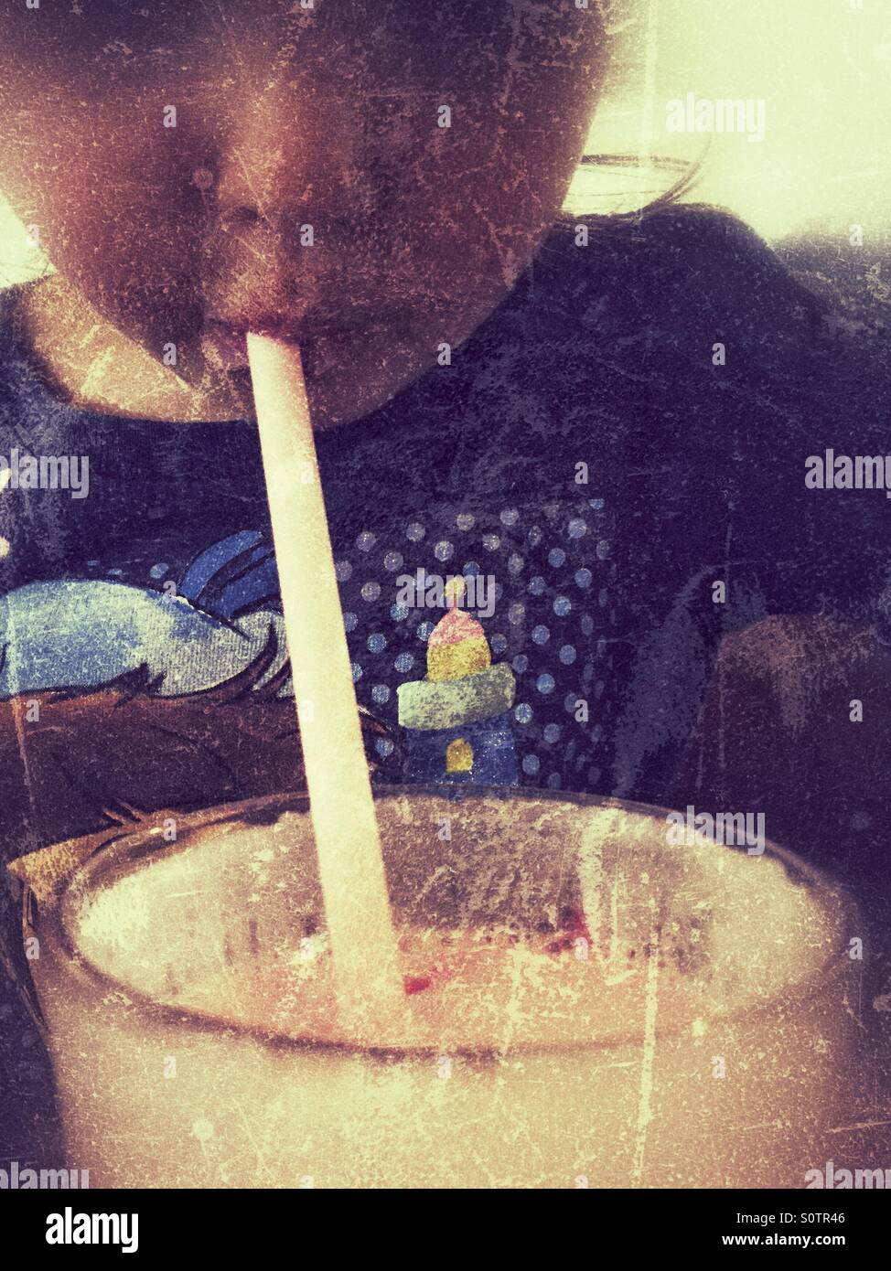 Drinking through a straw - Stock Image
