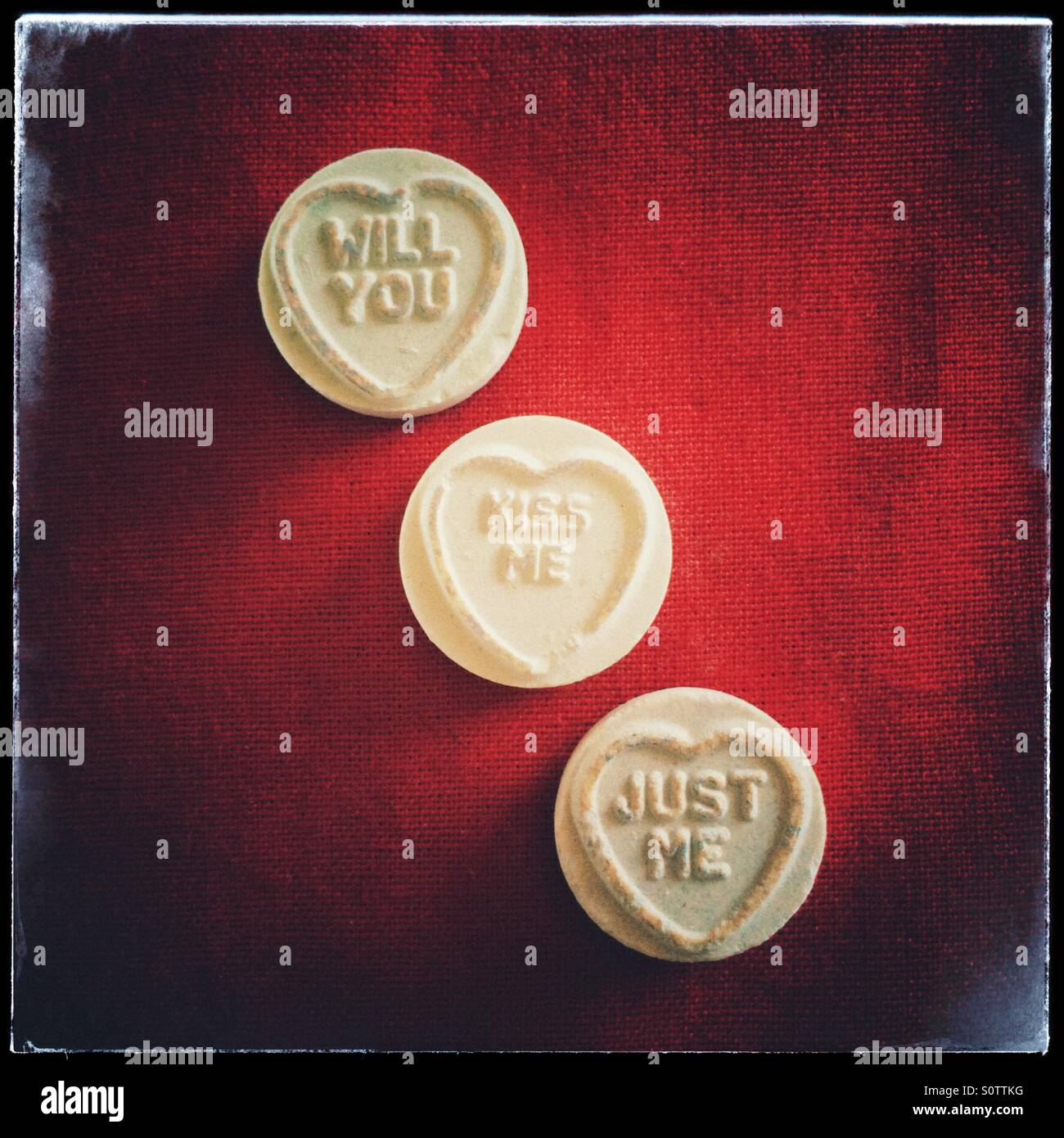 Will you, kiss me, just me, loveheart sweets. - Stock Image