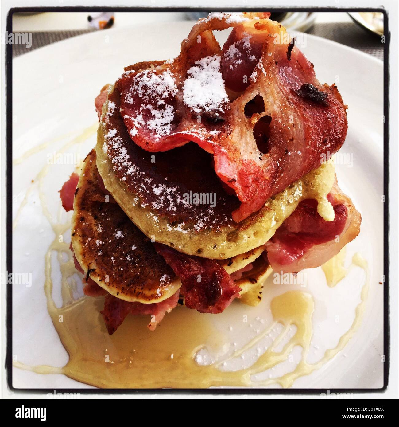 Pancakes and bacon breakfast brunch - Stock Image
