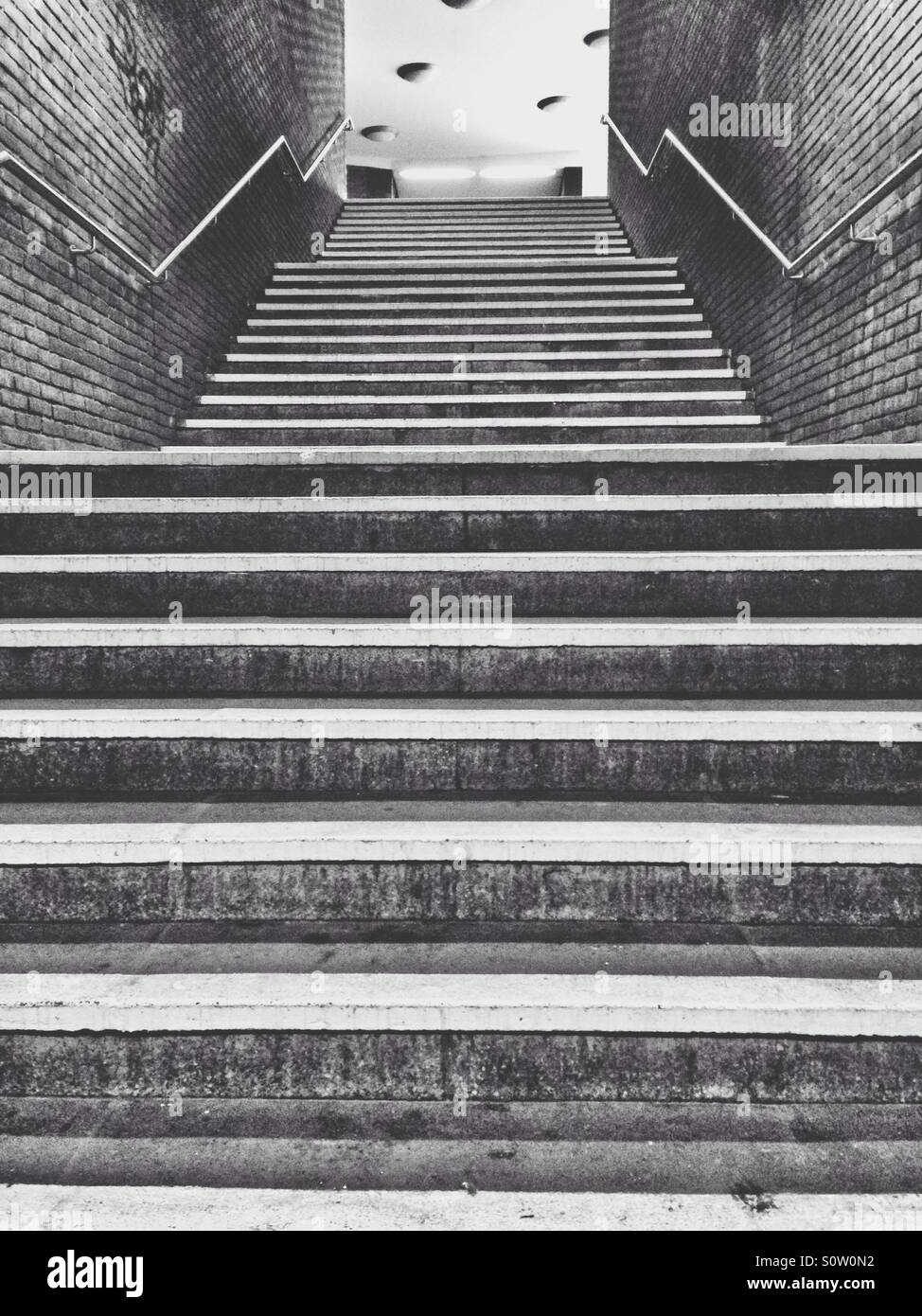 Stairs in a subway station looking up - Stock Image