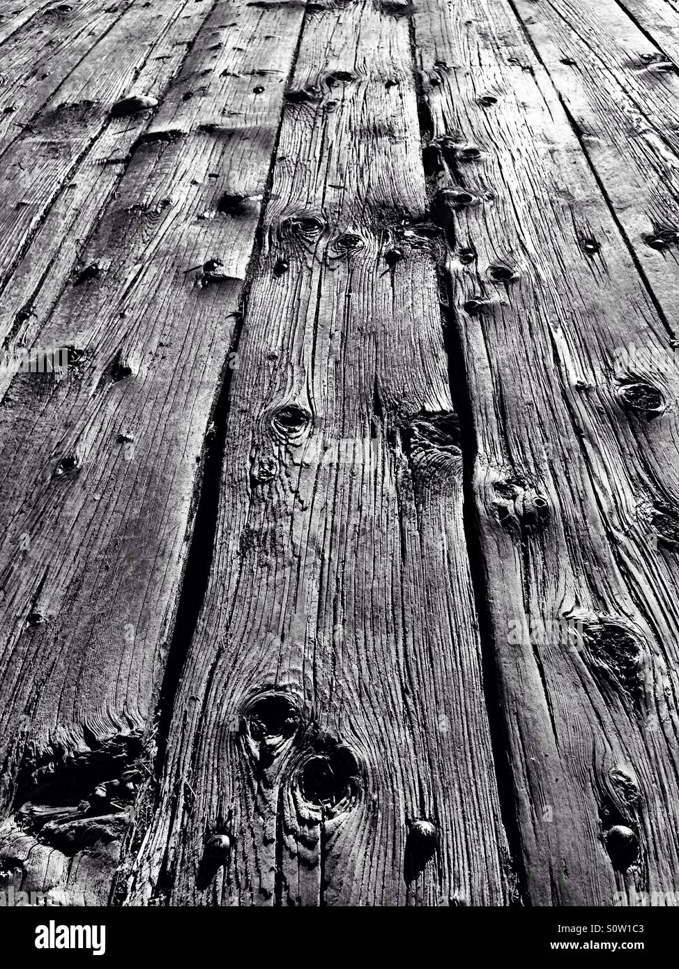 Sturdy boards on a pier - Stock Image