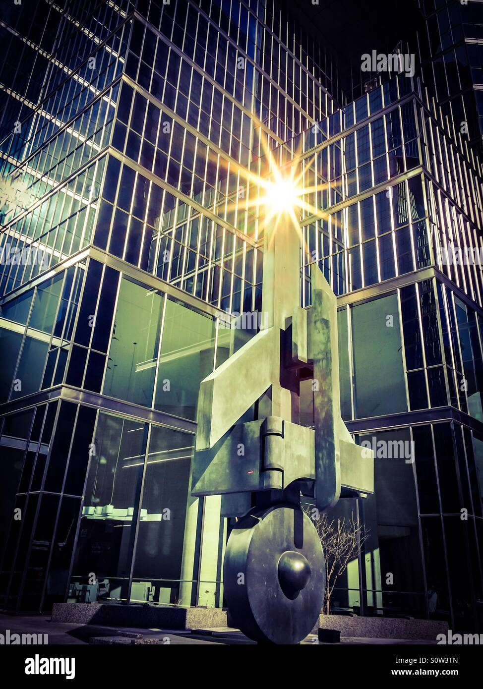 Sun bounces off famous modern sculpture against the background of Highrise buildings , Toronto, Canada - Stock Image