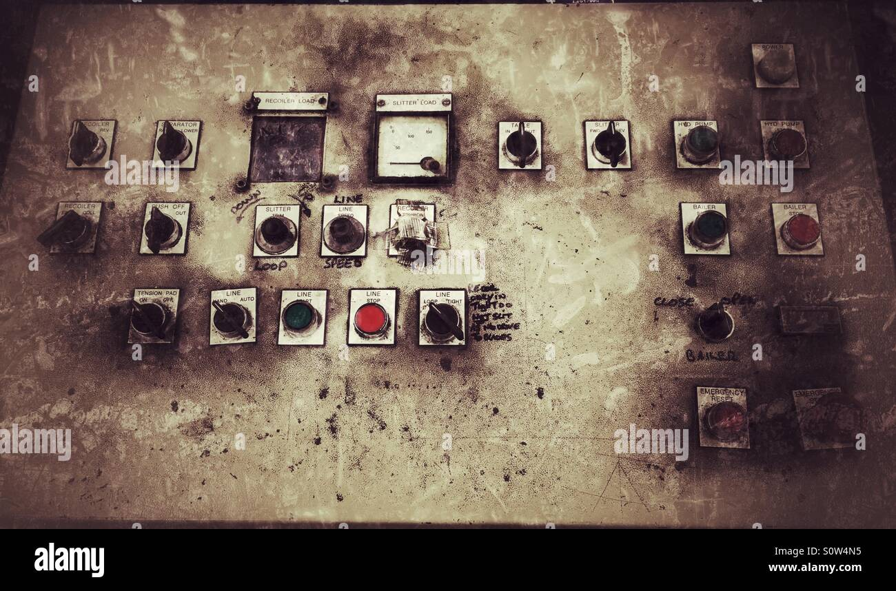 Old control panel for a slitting machine Stock Photo