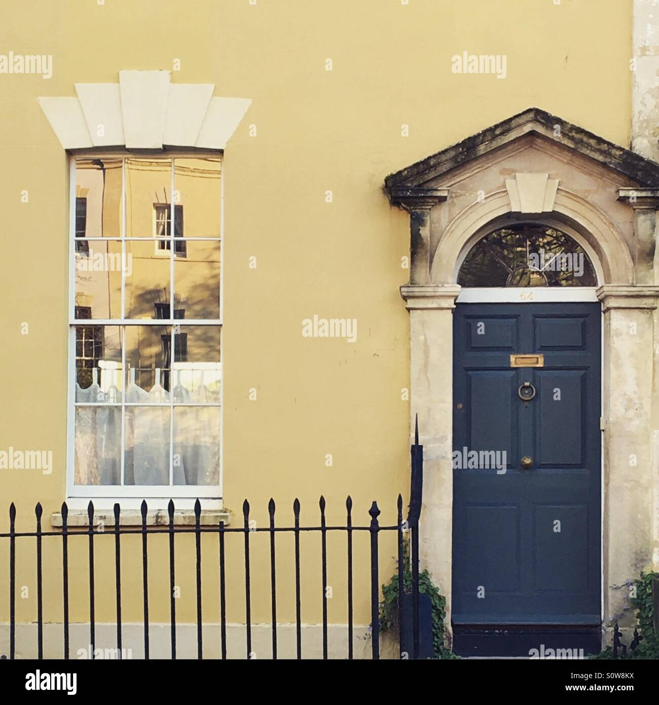 Painted Yellow House With Dark Blue Front Door In Bristol