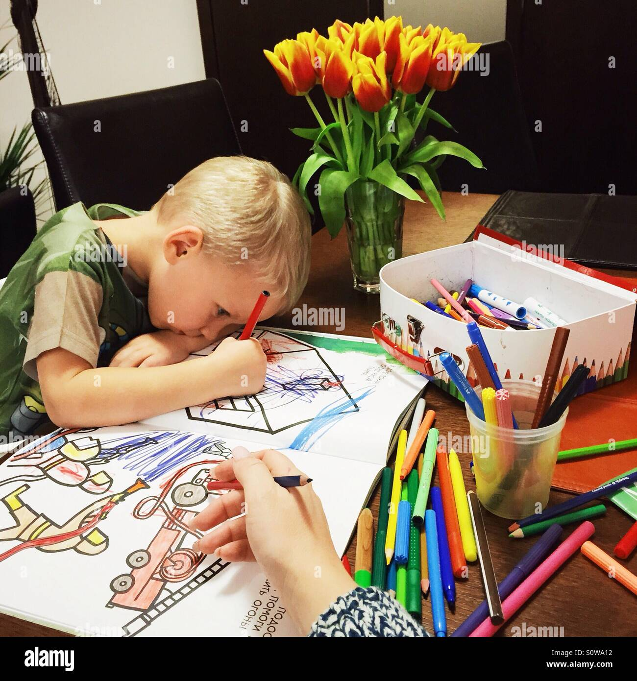 Little boy coloring a color book Stock Photo: 310343294 - Alamy