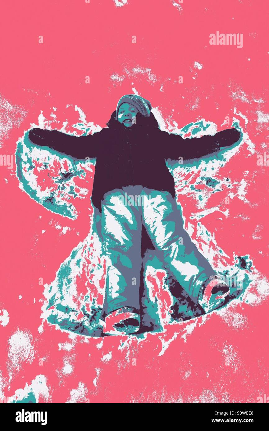Young girl making a snow angel with a pop art style filter - Stock Image