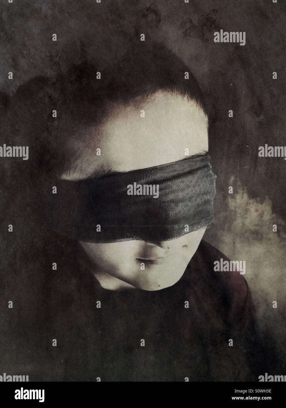 Blindfolded boy - Stock Image