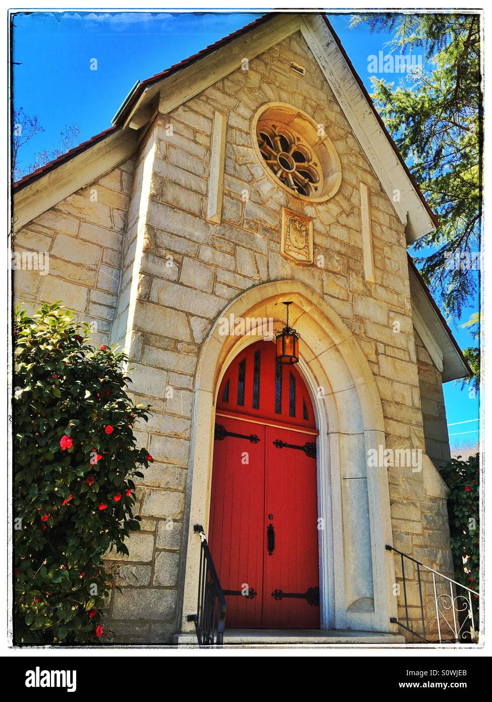 Church front with red doors - Stock Image