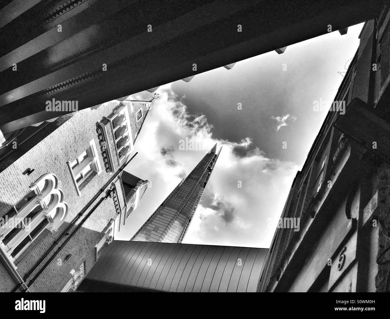 The shard, seen from below nearby railway bridges at Borough market. London, U.K. - Stock Image