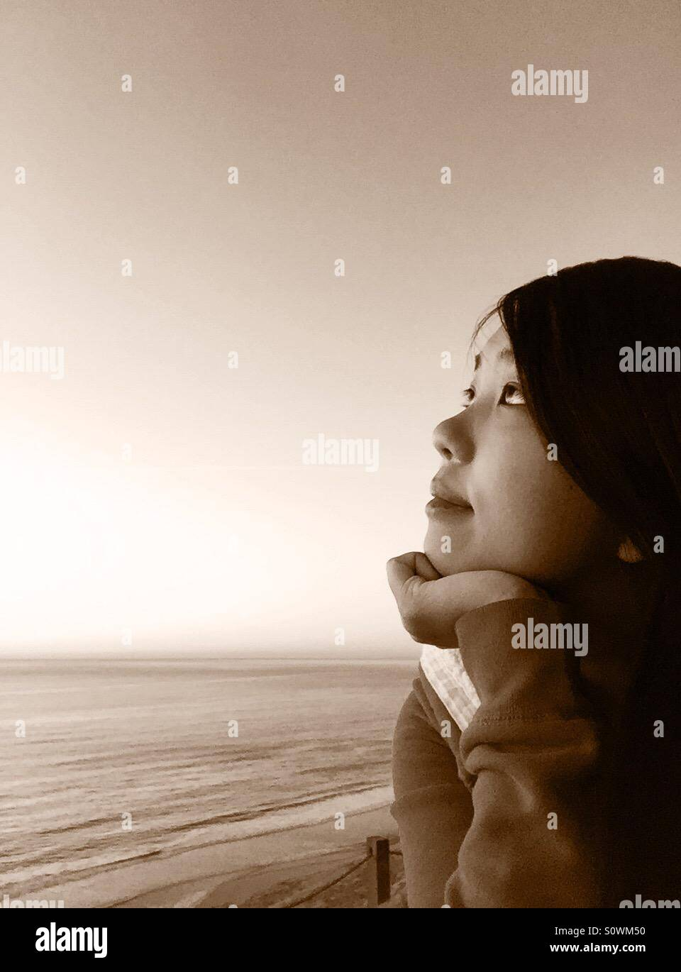 Thinking at the cliff - Stock Image