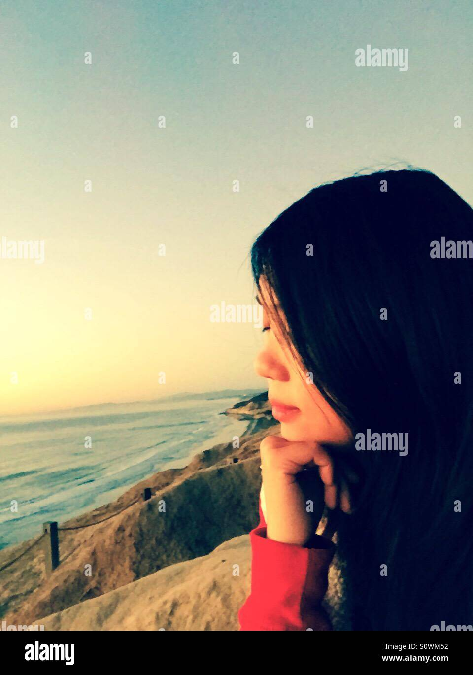 Listening to the ocean ,feeling the nature - Stock Image