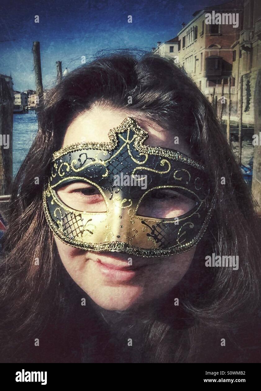 Tourist woman with venetian mask Stock Photo