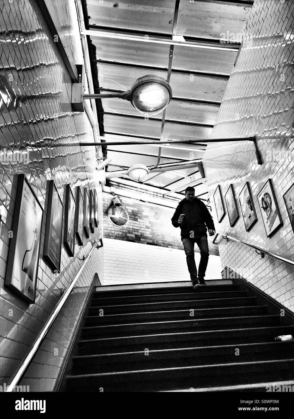 Man on steps. Zigzag shapes - Stock Image