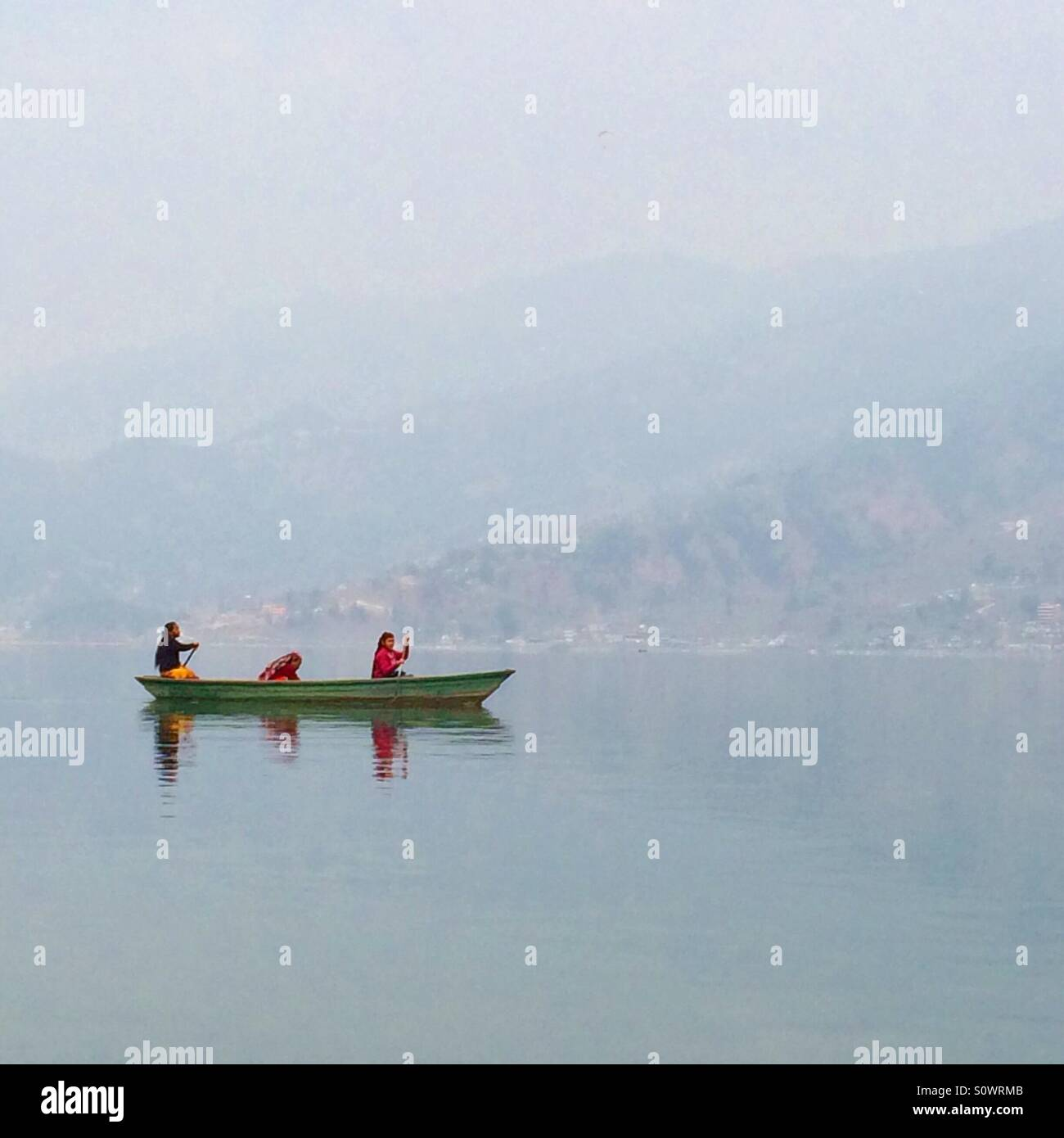 Women in the boat Fawa Lake Pokhara Nepal - Stock Image