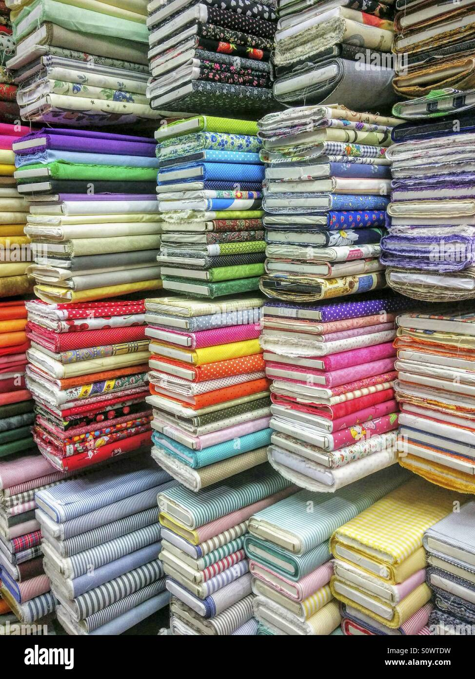 Fabrics in a store. - Stock Image