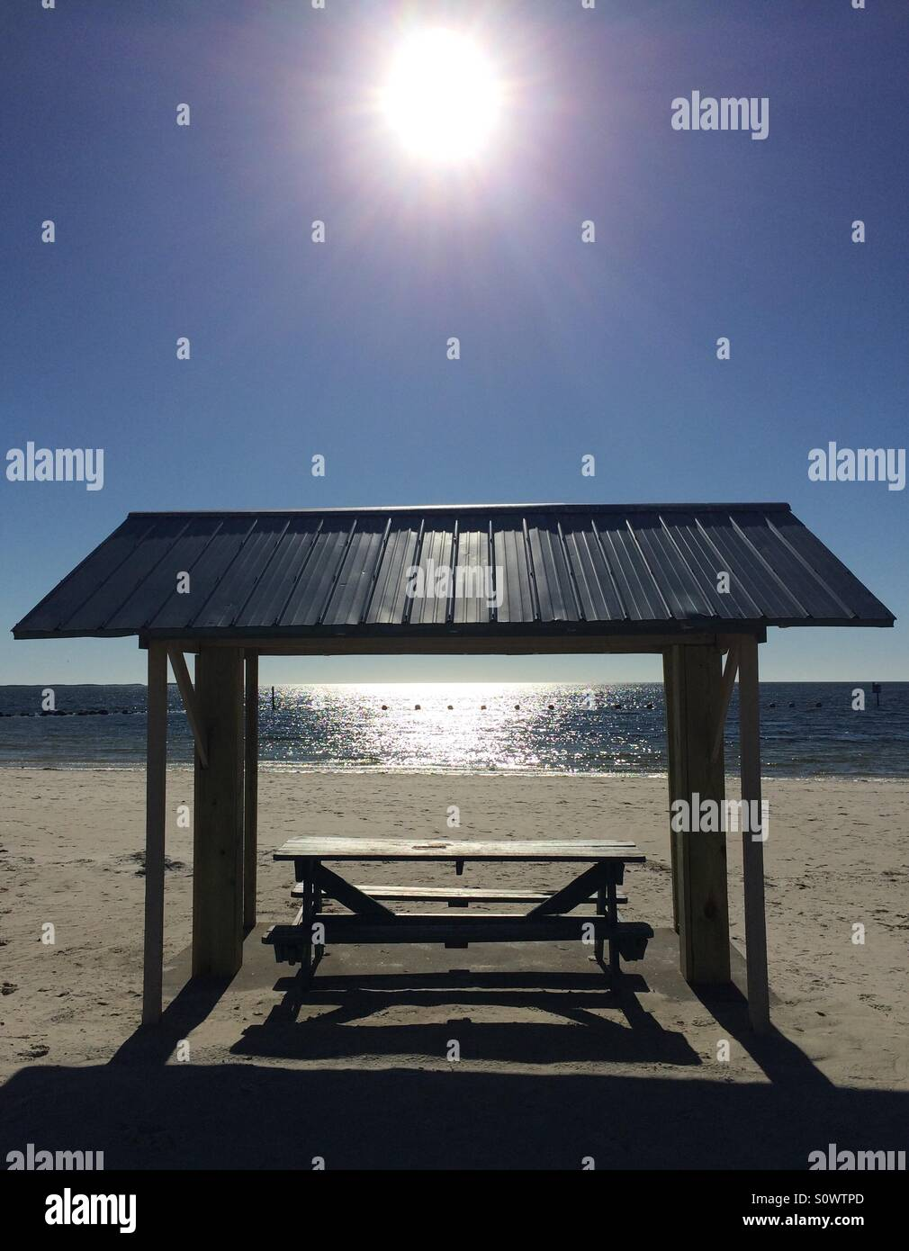 Picnic table at the beach - Stock Image