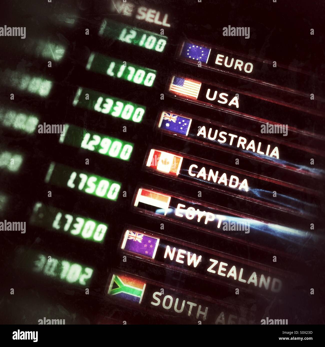 Currency exchange board with rates of exchange against the UK pound sterling Stock Photo