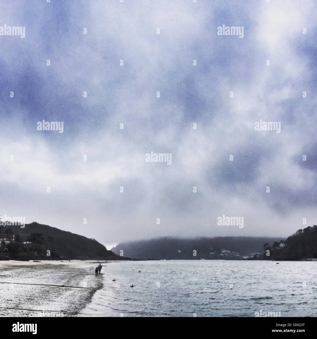 Lonely walk on the beach in winter at Salcombe, Devon Stock Photo