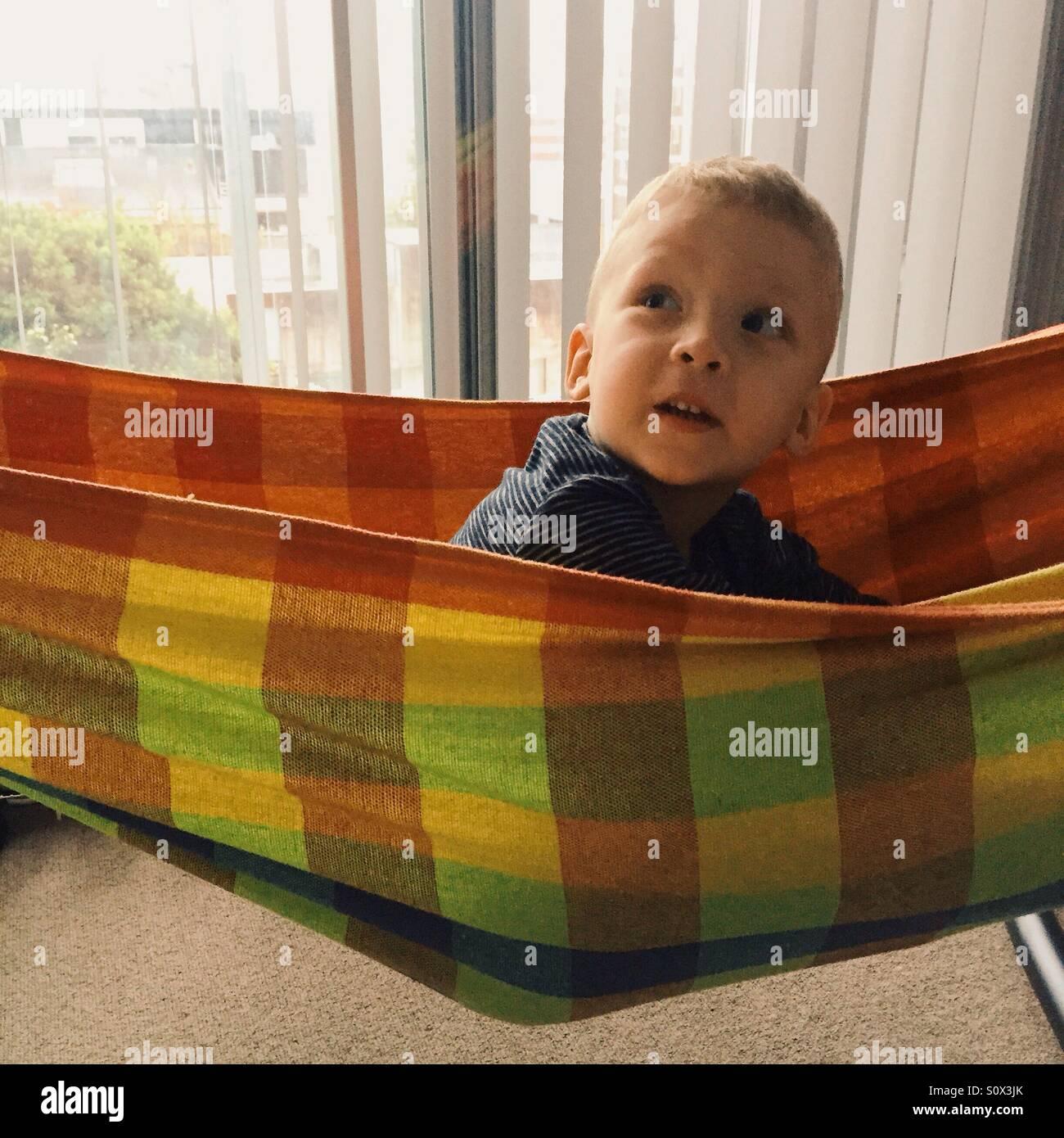 Little boy in hammock - Stock Image