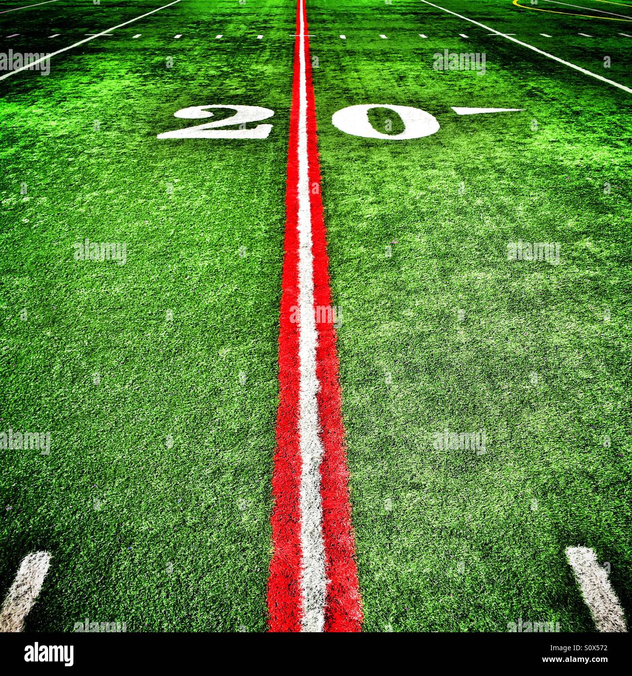 Twenty yard line painted red on an American football field - Stock Image