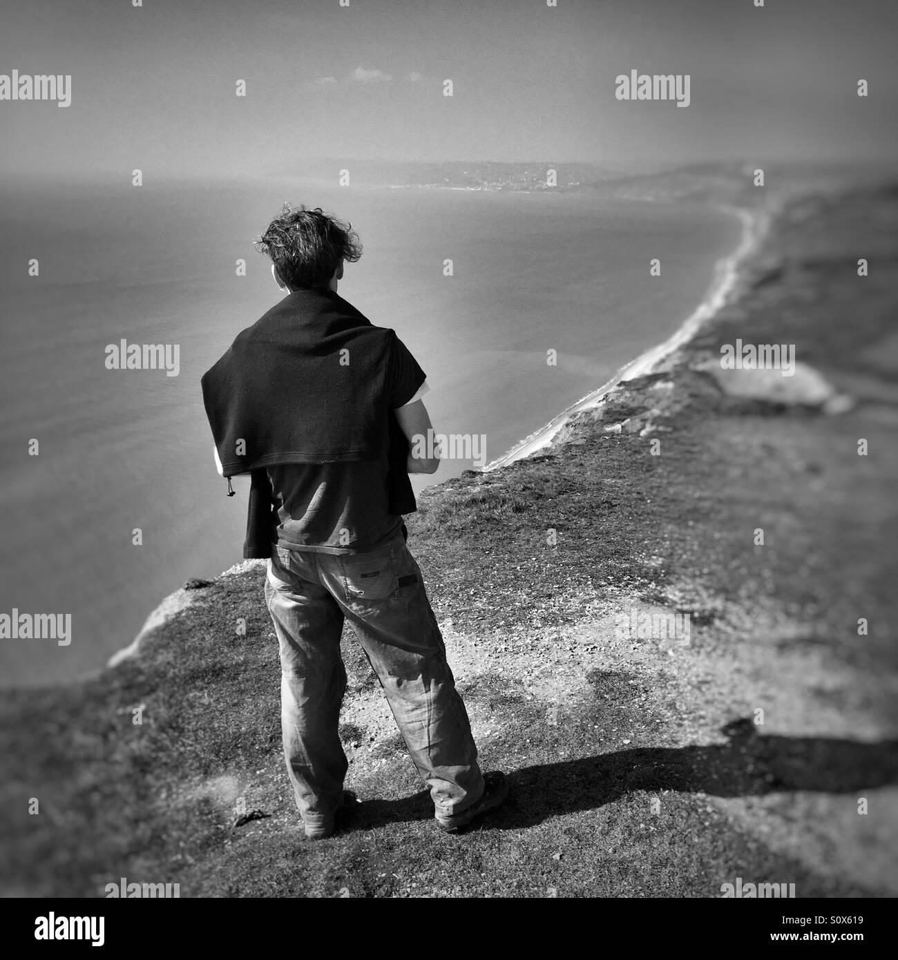 Walker admiring the view from Golden Cap in Dorset Stock Photo