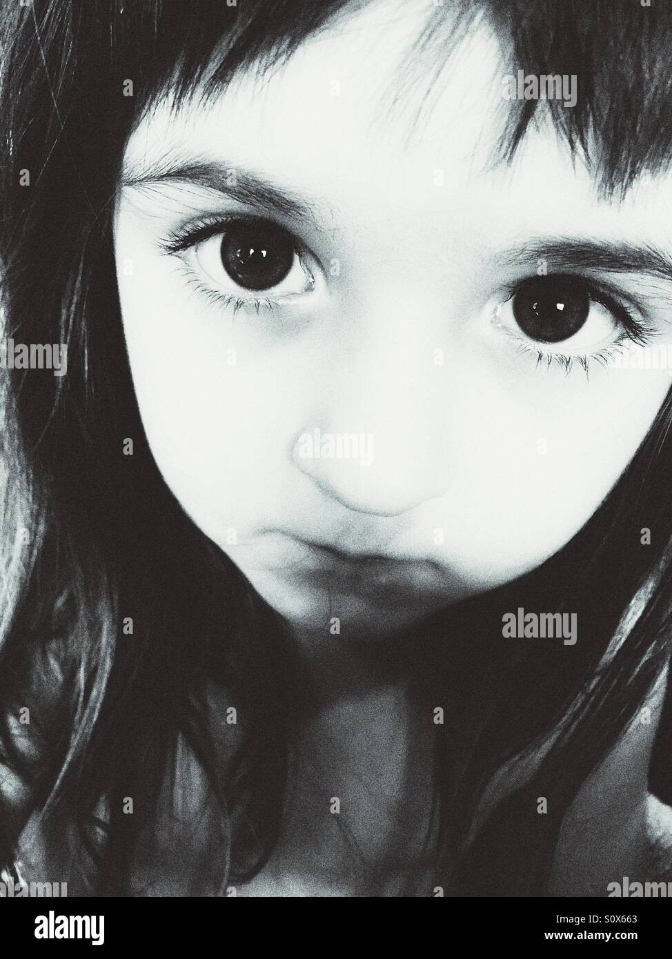 Black and white portrait of Caucasian girl. - Stock Image