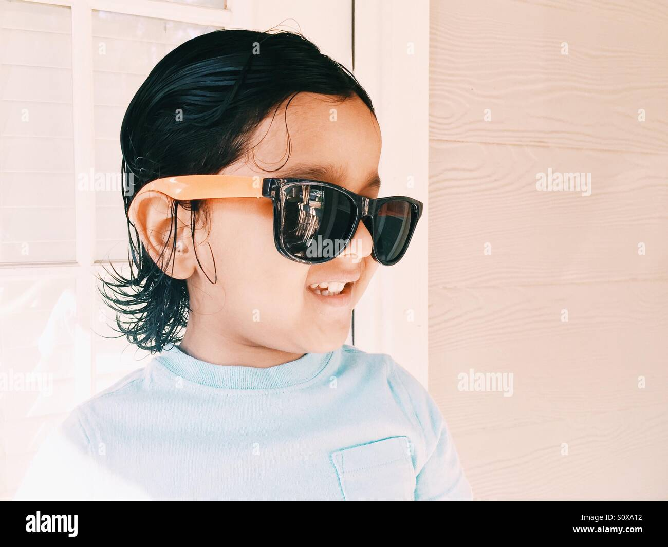 b1976847d6efc Cool dude kid in sunglasses in summertime Stock Photo  310365246 - Alamy