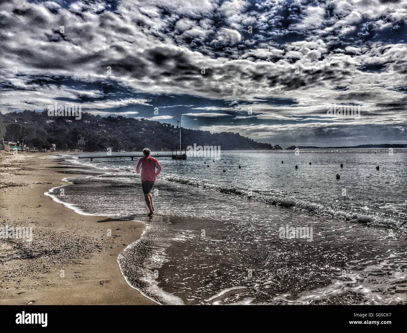 Jogging at the beach, Mediterranean Sea,Côte d'Azur, France Stock Photo