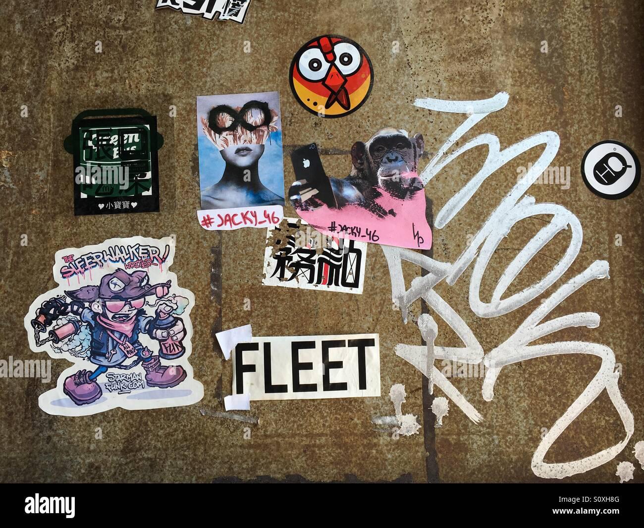 Graffiti Street Art and Stickers in Shenzhen - China - Stock Image