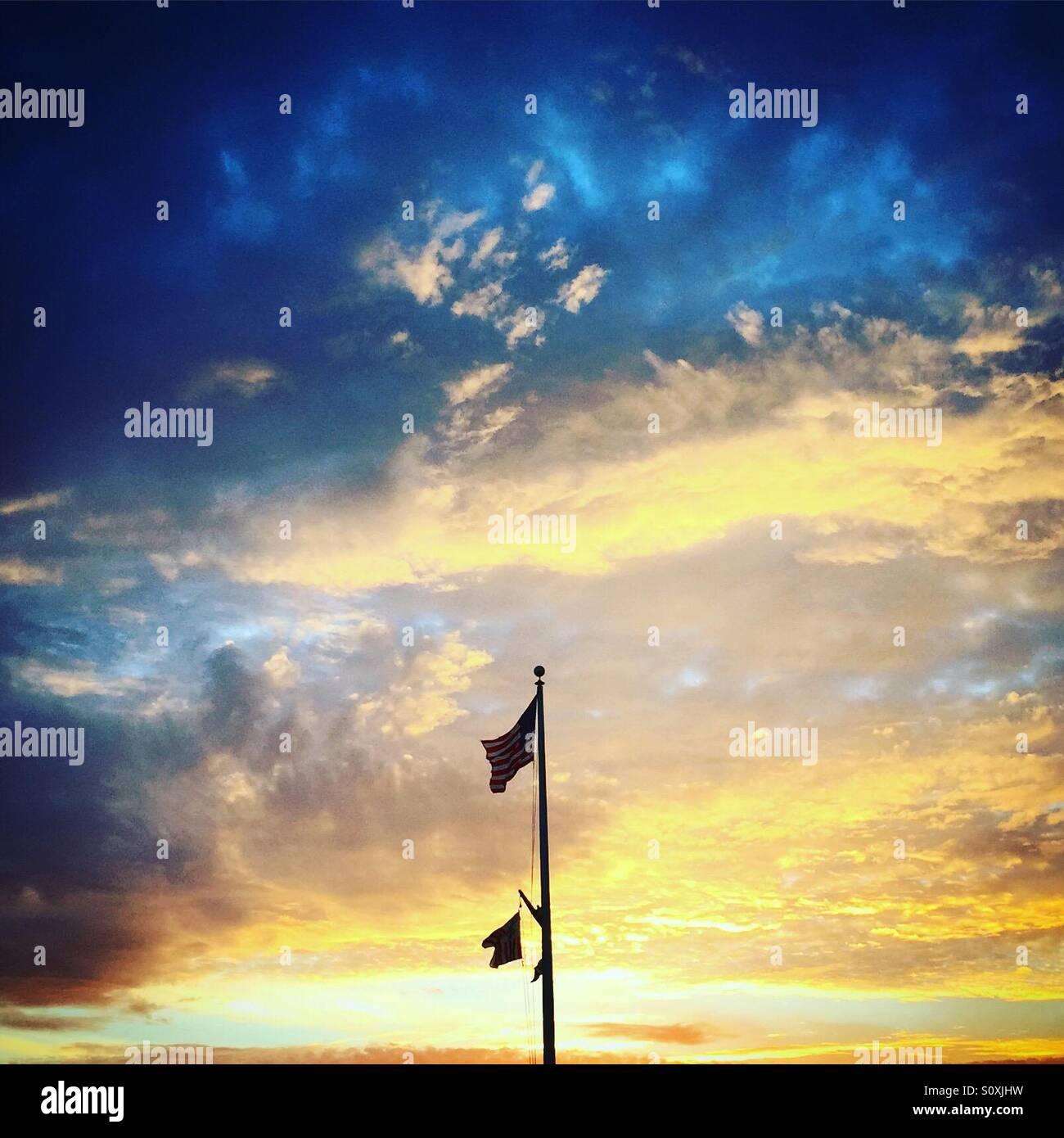 Flagpole at sunset - Stock Image