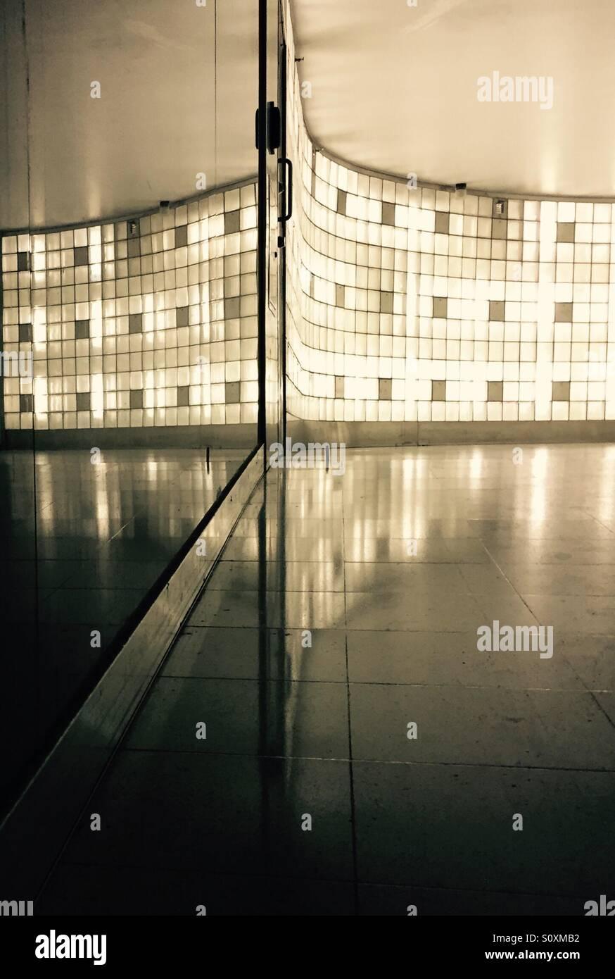 Reflection of a glass wall at University of Helsinki metro station, Finland - Stock Image