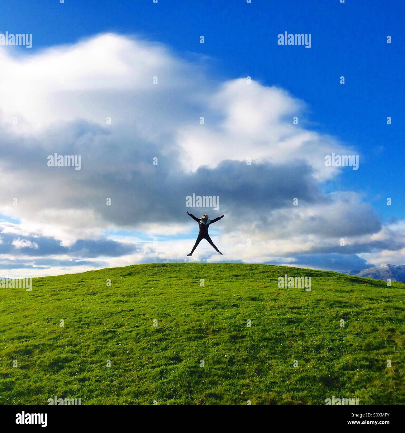 Photo taken walking up hills in the beautiful English countryside, near lake Windermere, With a happy individual - Stock Image