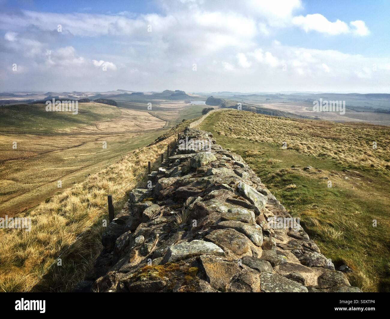 A view of Hadrian's Wall near Steel Rigg in Northumberland in England. Hadrian's Wall was just one of four - Stock Image