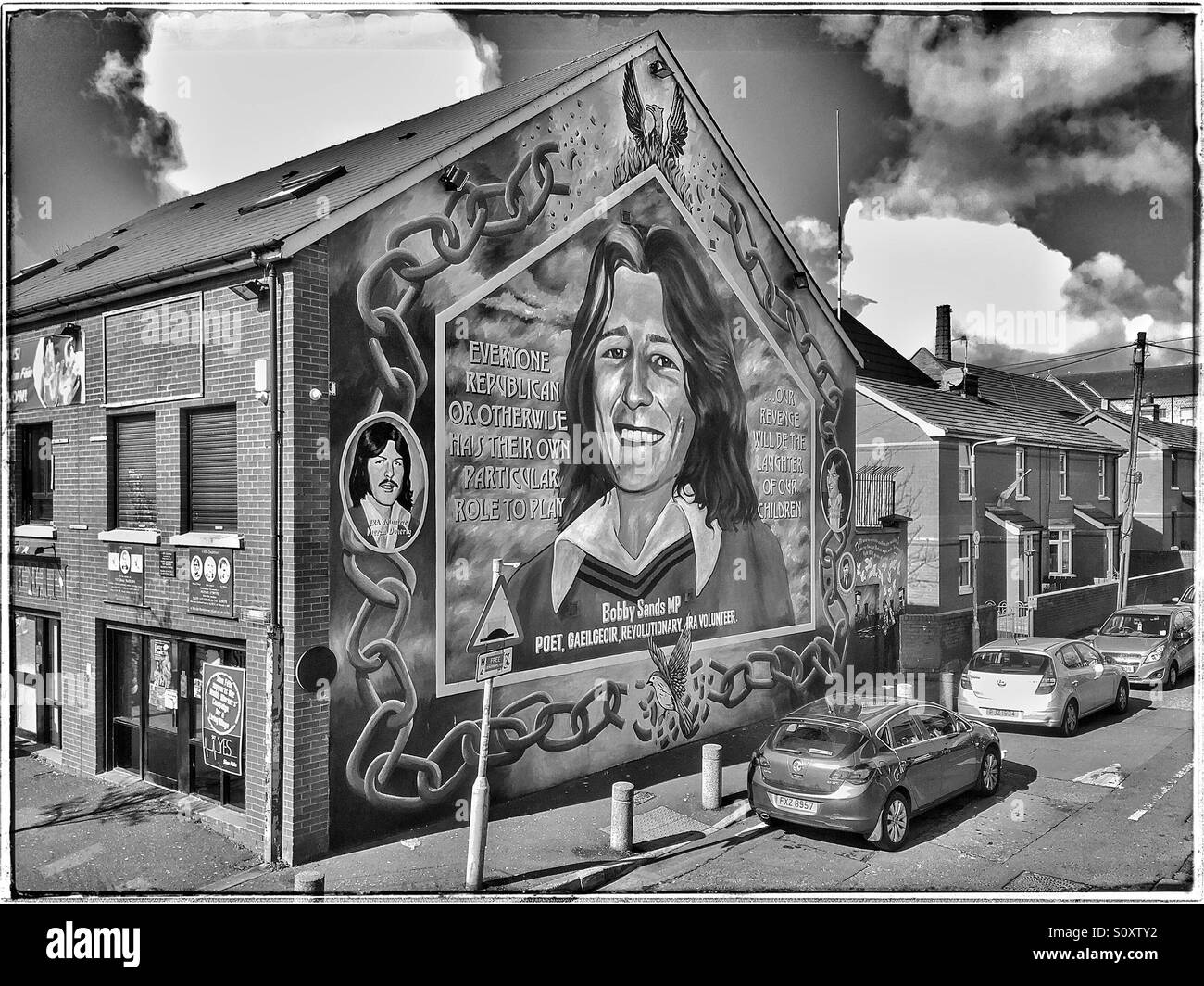 The Bobby Sands Memorial Mural, Painted on the Gable Wall of the Sinn Fein Headquarters Building in the Falls Road - Stock Image