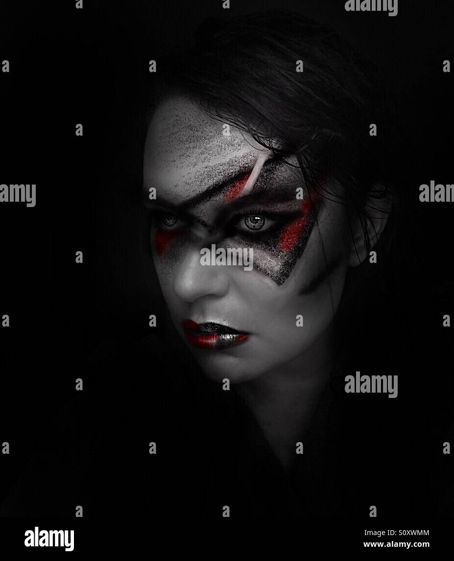 Creative self portrait, woman with war paint - Stock Image