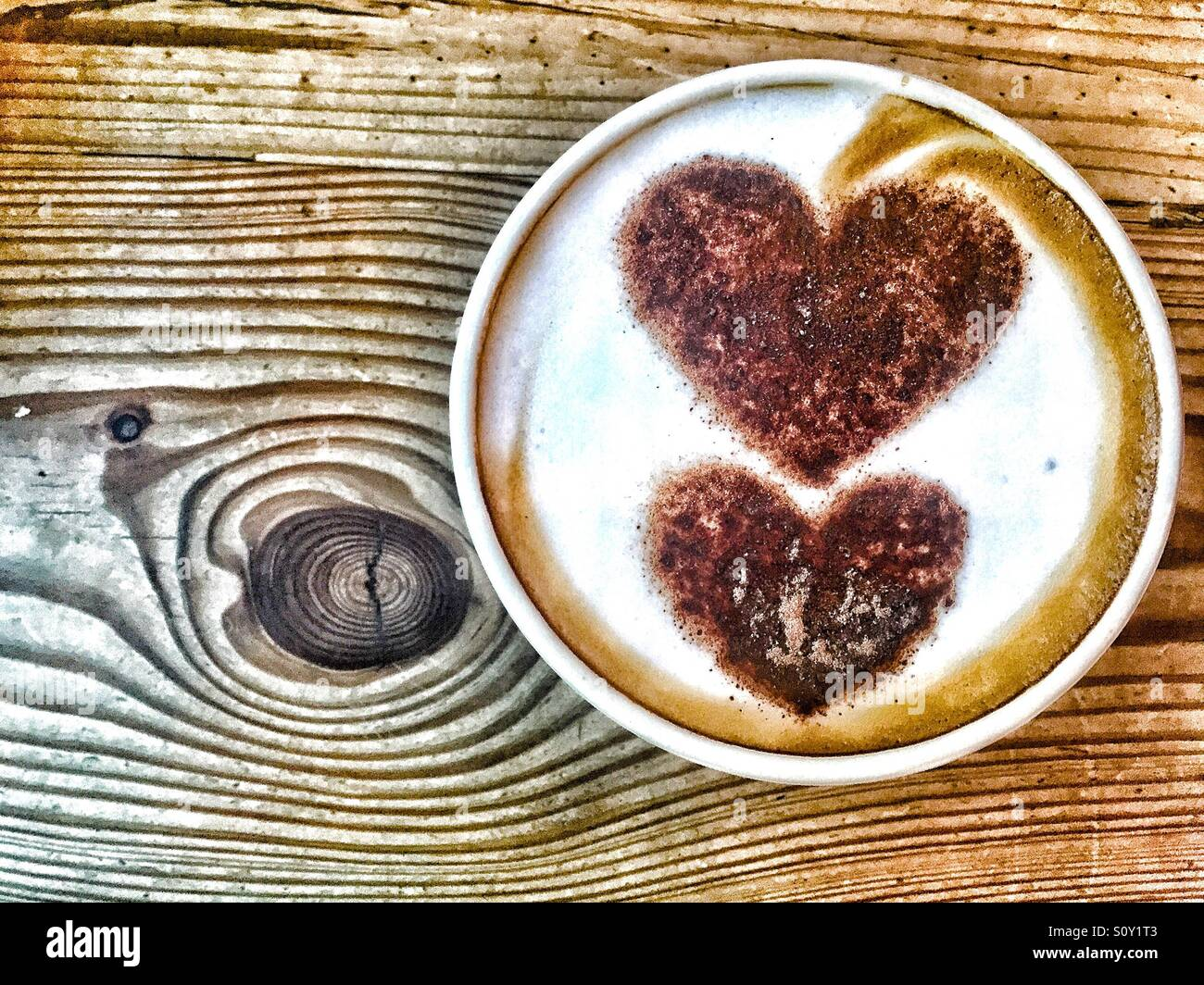 Late art hearts in cappuccino cup - Stock Image