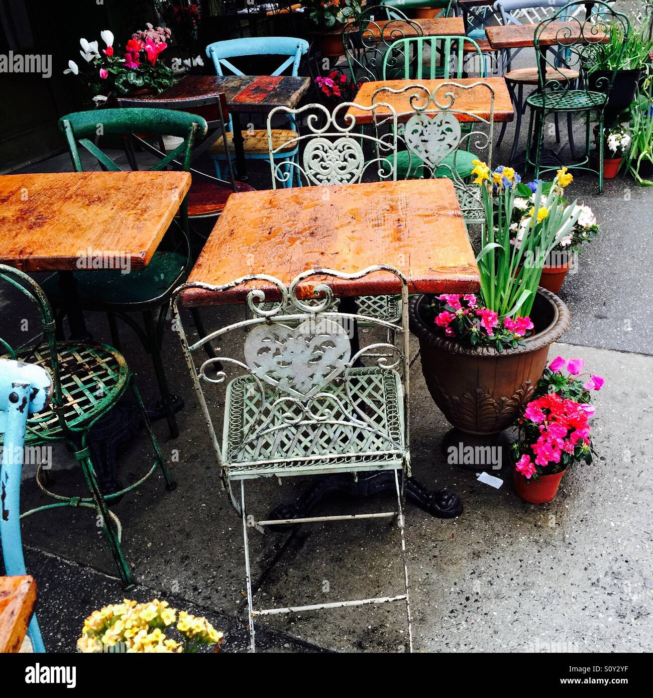 Empty tables and chairs at the sidewalk cafe Olio e Piu in Greenwich Village, New York City Stock Photo