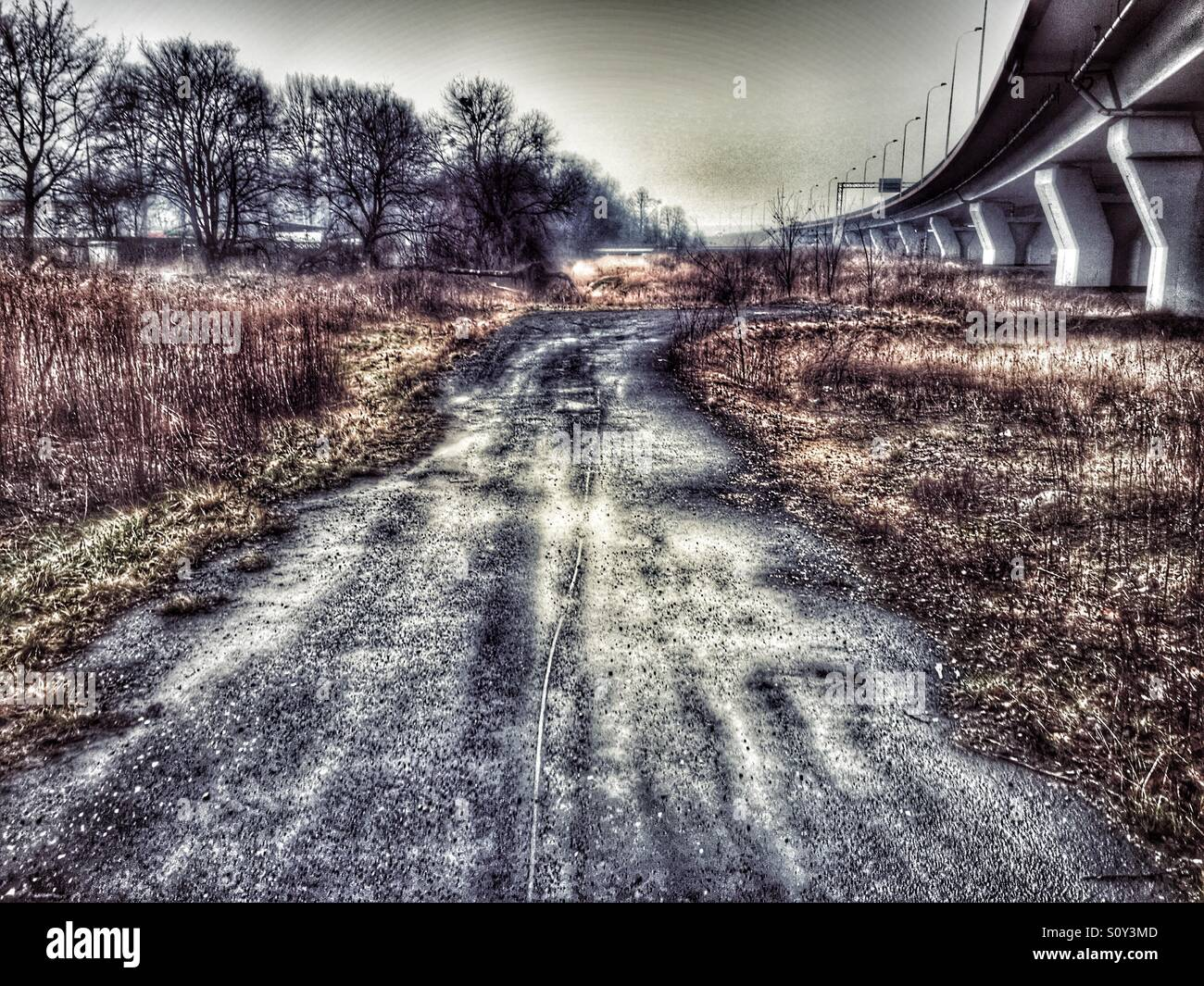 Apocalyptic view of road to nowhere and viaduct - Stock Image