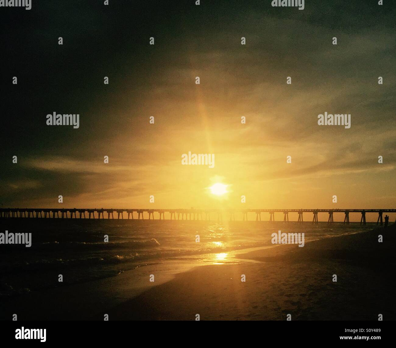 Sunsetting over pier - Stock Image