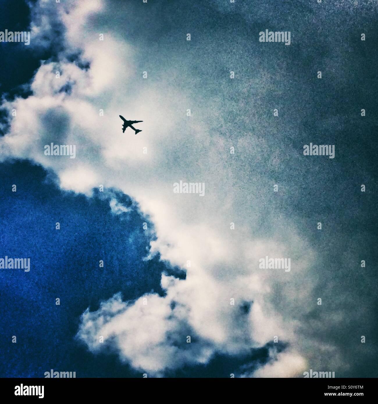 An aeroplane in the sky - Stock Image