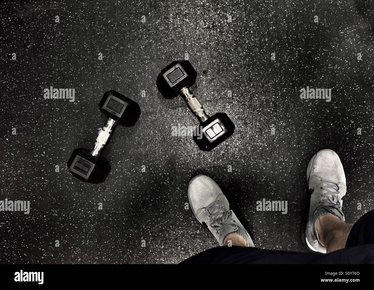 Barbells and feet - Stock Image
