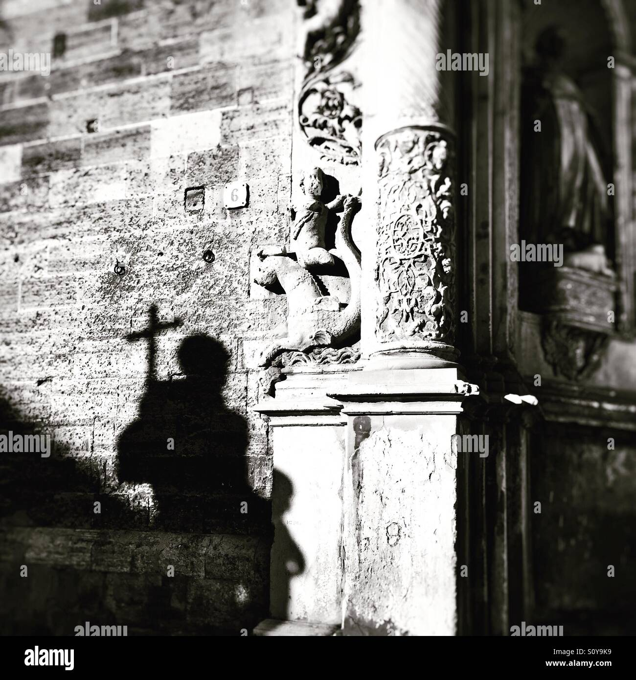 Shadow of St Francis statue in Palma, Majorca. Black and white Stock Photo