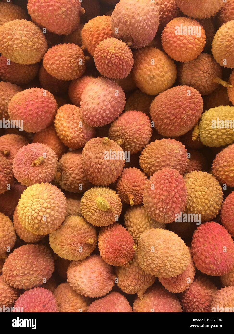 Stack of fresh lychees - Stock Image